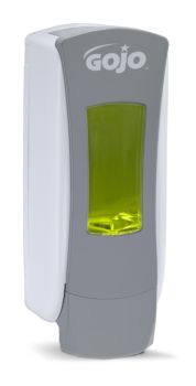 dispenser with yellow soap packet loaded