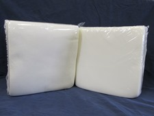 two packages of white cloth