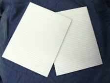 standard paper pad, ruled white, no branding