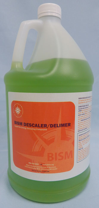 clear jug with green liquid inside, orange label - BISM DESCALER/DELIMER
