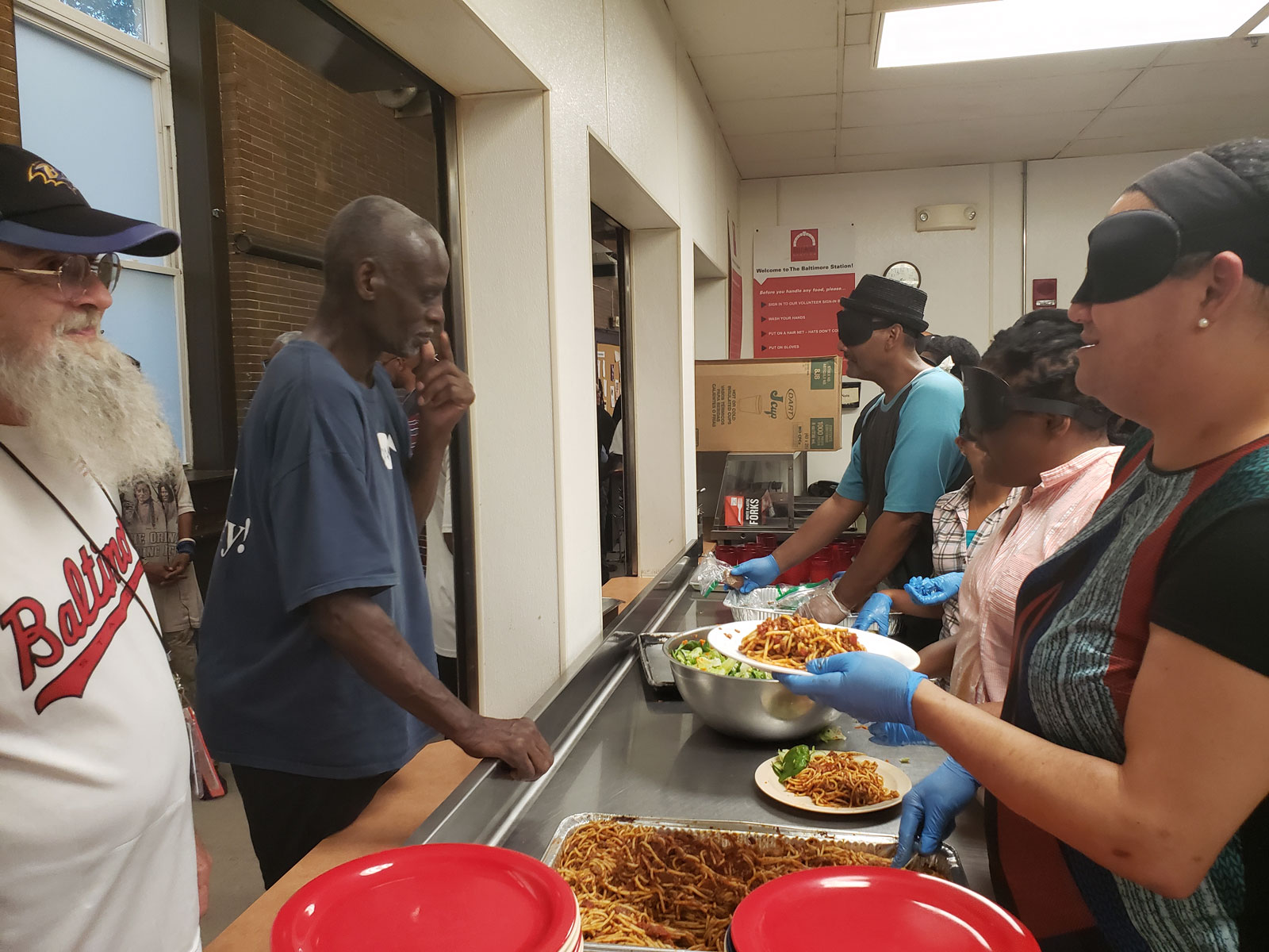 CORE students serving dinner to Baltimore Station veterans